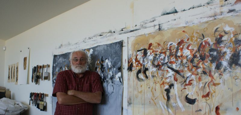 The artist with two of his most recent paintings.